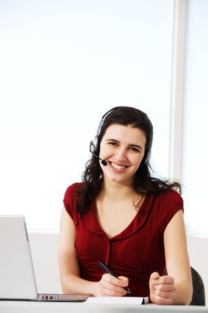 cute woman worker in an office with a headset Stock Photo - 2831292