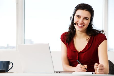 cute woman worker in an office with a headset Stock Photo - 2831294