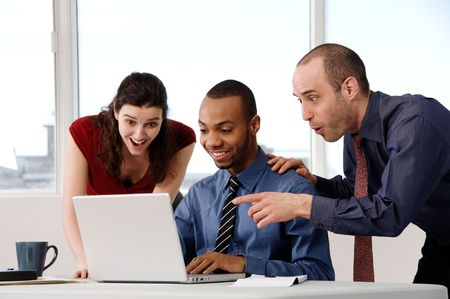 business team in an office on a laptop Stock Photo - 2856874