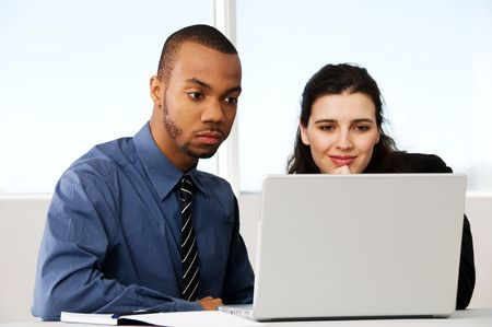 two business associates with a grey laptop Stock Photo - 2876260