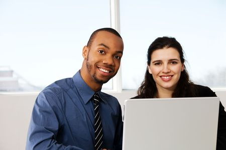 two business associates with a grey laptop Stock Photo - 2876257