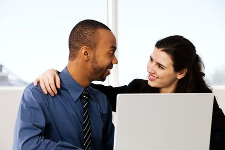 two business associates with a grey laptop Stock Photo - 2876261