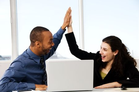 two business associates with a grey laptop Stock Photo - 2876258