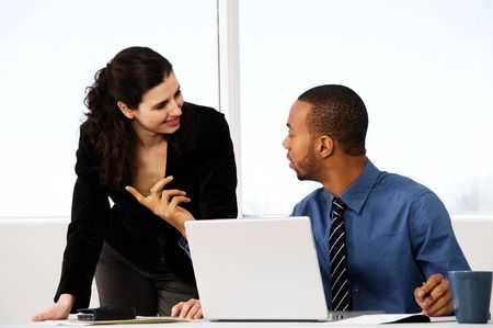 two business associates with a grey laptop photo