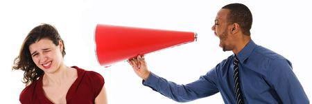 business man with megaphone harrassing colleague photo