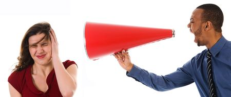 harass: business man with megaphone harrassing colleague