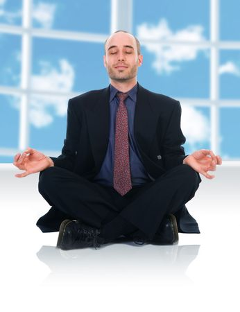 lotus pose: business man in a meditation position on white