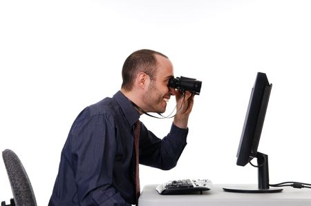 binocular: business man looking at a computer monitor
