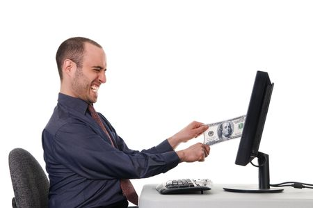 web scam: business man pulling his money from a monitor Stock Photo
