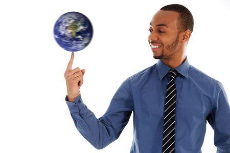 black business man: noir homme d'affaires tourne la terre sur doigt  Banque d'images