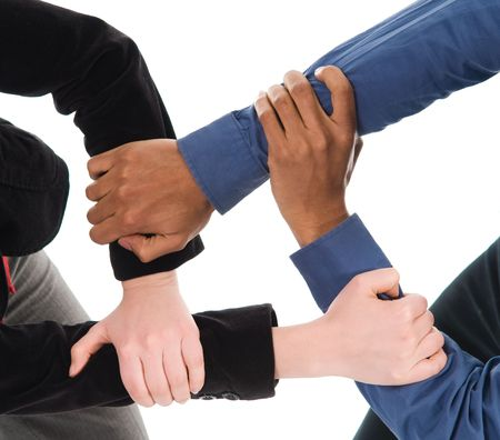 clasped hand: business people holding hands on a white background