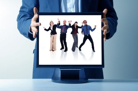 businessman holding an lcd monitor