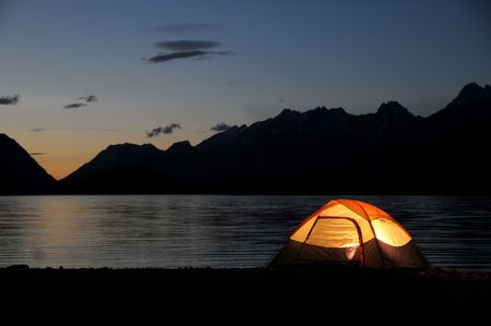 river: Evening lit tent in camping by nature