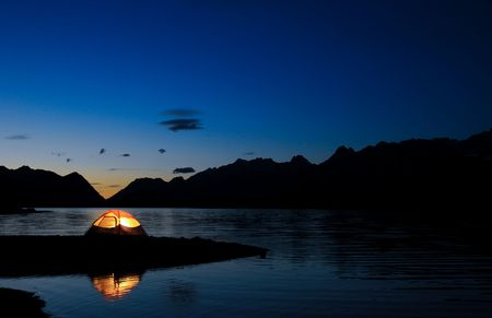 Evening lit tent in camping by nature Stock Photo - 3329595