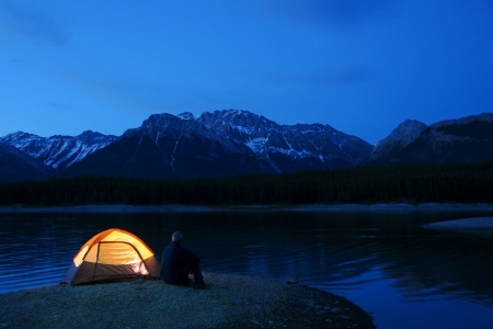 Evening lit tent in camping by nature Stock Photo - 3329646