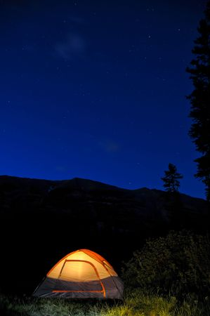 Evening lit tent in camping by nature Stock Photo - 3329596