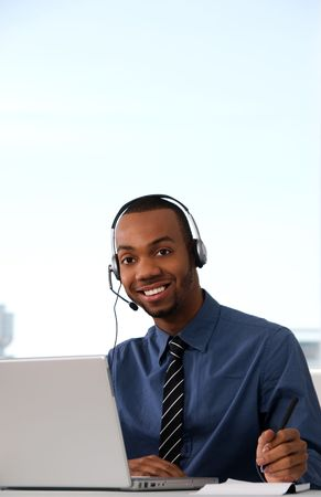 contact center: Customer Service agent in an office with laptop Stock Photo