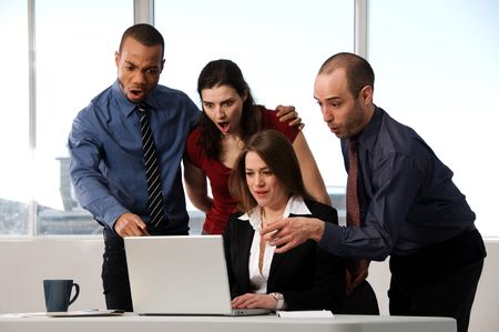 group of business people at an office desk Stock Photo - 3503857