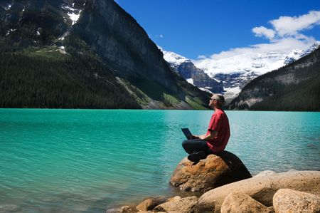 Man in red shirt on the lake shore Stock Photo - 3519204