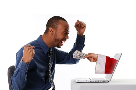 african business: man receiving a christmas gift by internet via santa Stock Photo
