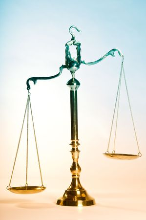 statute: Wooden justice gavel and block with brass