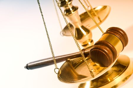 ruling: Wooden justice gavel and block with brass