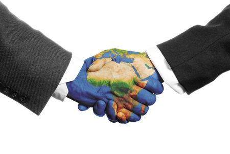 two hands shaking on a white background with a world map Stock Photo