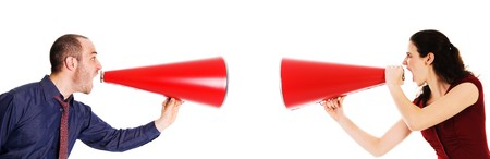 businessman and businesswoman holding a red megaphone conflict Stock Photo