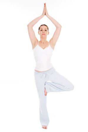 Beautiful woman doing yoga on isolated white background photo