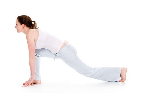 Beautiful woman doing yoga on isolated white background Stock Photo - 4034436