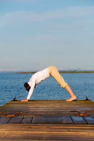 Yoga Woman on a dock by the ocean Stock Photo - 4171554