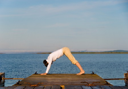 Yoga Woman on a dock by the ocean Stock Photo - 4171552