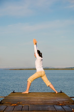 Yoga Woman on a dock by the ocean Stock Photo - 4171530