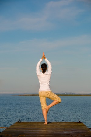 Yoga Woman on a dock by the ocean Stock Photo - 4171527