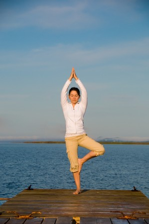 Yoga Woman on a dock by the ocean Stock Photo - 4171553
