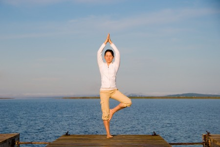 Yoga Woman on a dock by the ocean Stock Photo - 4171523