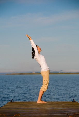 Yoga Woman on a dock by the ocean Stock Photo - 4171522