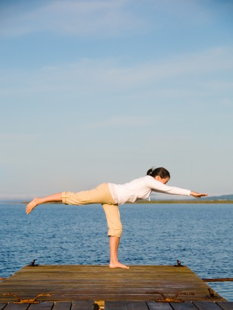Yoga Woman on a dock by the ocean Stock Photo - 4171520