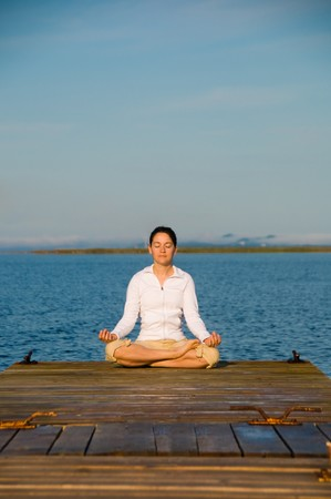 Yoga Woman on a dock by the ocean Stock Photo - 4171529