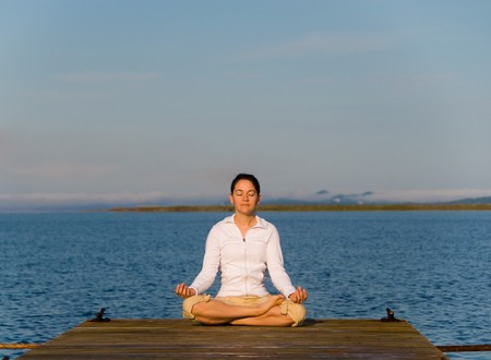 Yoga Woman on a dock by the ocean Stock Photo - 4171525