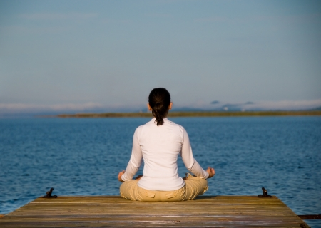 Yoga Woman on a dock by the ocean Stock Photo - 4171528
