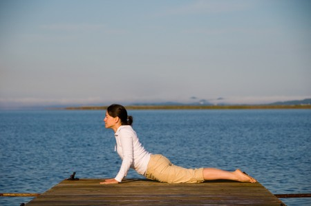 Yoga Woman on a dock by the ocean Stock Photo - 4218224