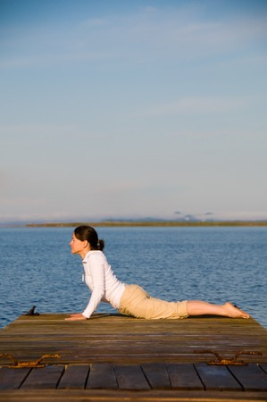 Yoga Woman on a dock by the ocean Stock Photo - 4218225