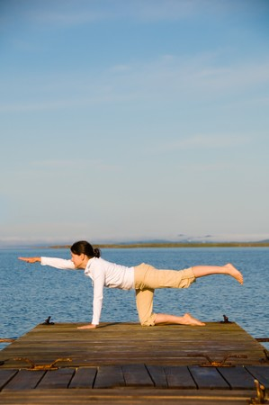 Yoga Woman on a dock by the ocean Stock Photo - 4218221