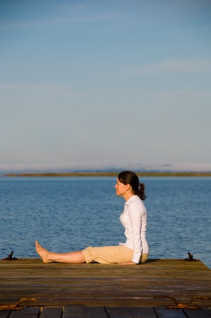 Yoga Woman on a dock by the ocean Stock Photo - 4218223
