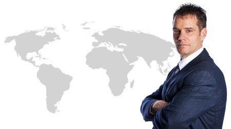Businessman International on a world map isolated photo