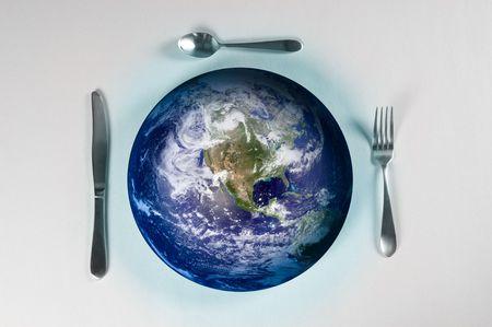 プレート: 世界の飢餓の皿の上の地球 写真素材