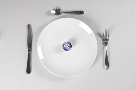 planet earth on a plate for world hunger photo
