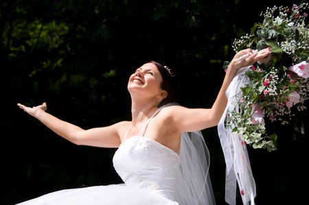 vow: White Bride at her wedding posing with veil