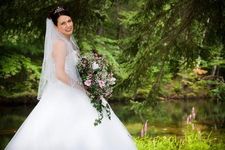 whitem: White Bride at her wedding posing with veil